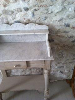 The bedroom with it's exposed stone-walls and vintage washstand