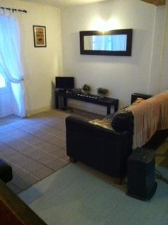 The spacious lounge is equipped with a TV with USB port and DVD player