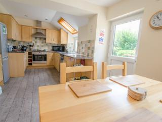 Modern country styled kitchen/breakfast room with dishwasher, fridge freezer, microwave