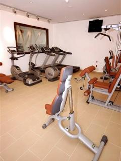 Gym at clubhouse can be used by villa Guest also a outside Tennis court