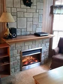 Electric fireplace with heat option and several mood settings