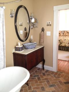 Master bathroom with antique vanity and makeup mirror
