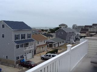 Ocean view from rooftop deck with deluxe outdoor furniture