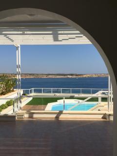 View through onto pool and sea