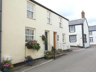The cottage is tucked away in a quiet lane off the village square.