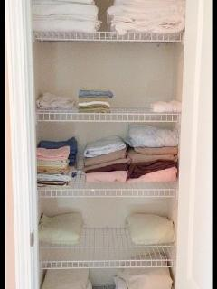 Linen closet with plenty of towels and bed sheets
