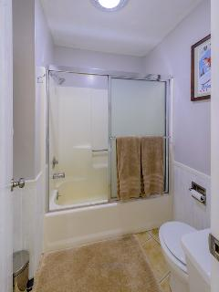 Bathroom with tub and shower. High quality towels provided.