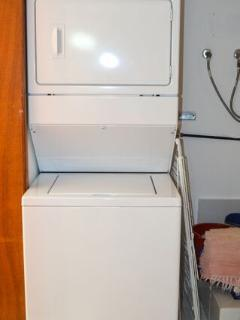 Full size stacking washer/dryer in laundry closet