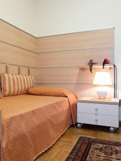 Bedroom with two beds (one missing)