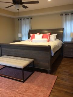master bedroom with king bed and 40' Smart TV