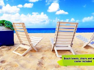 Beach towels, beach chairs, and wheeled cooler provided. Just take them and enjoy!