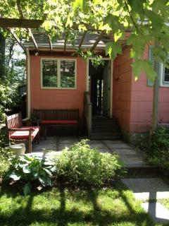 Cottage is surrounded by beautiful gardens.