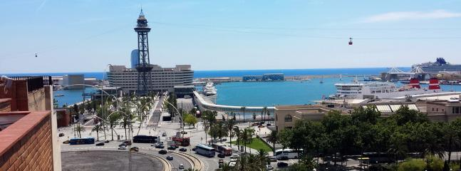 View from the building roof on the sea, old harbour, Plaça de les Drassanes and Hotel W
