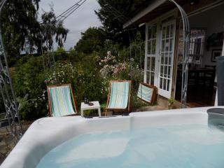 Summer by the Hot Tub is wonderful and relaxing. Surrounded by scented roses.