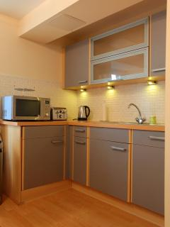 This well appointed kitchen has a fridge-freezer, oven & hob, dishwasher, microwave, etc