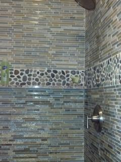 Custom master bathroom shower; Cris made some of the embedded ceramics