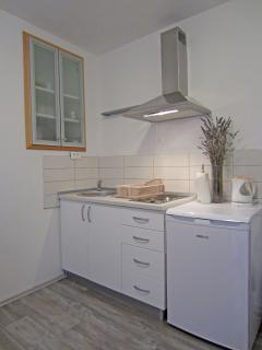kitchen in a pinjk lemon apartment