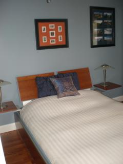 Queen size bedroom with desk and TV