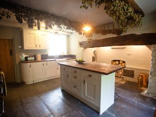 part of the kitchen, with original slate floor and inglenook. Utility room adjacent with mod cons