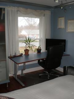Desk with TV in queen size bedroom