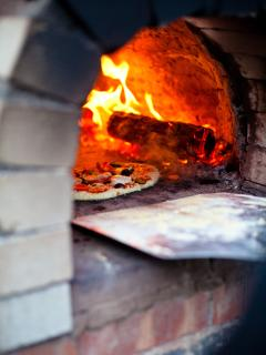 have a go at cooking your own pizzas on our wood fired clay oven