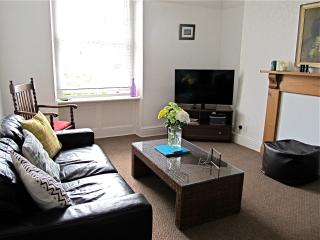 with comfortable leather sofas and lots of natural light