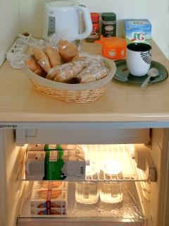 A fridge and a kettle for you and free coffee, tea, cupcakes, croissants, milk and juice.
