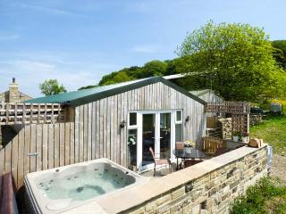 THE OLD PIGGERY, single-storey, detached wooden cabin, en-suite, WiFi, hot tub