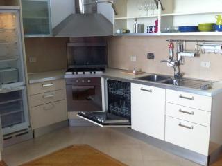 Kitchen with microwave, dishwasher, freezer, refidgerator, stove