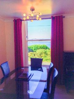 Dining table with views over Ascog Bay