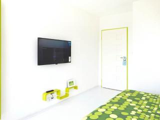 In master bedroom is a comfortable large double bed (160 cm width) and a 40 inch TV on the wall.