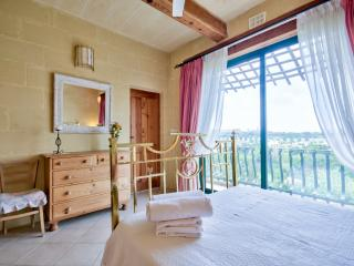 2nd floor bedroom with balcony and country views