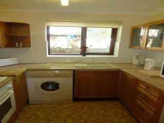 Kitchen with freege/freezer, microwave.
