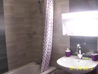 double bedroom en-suite  with shower and bath