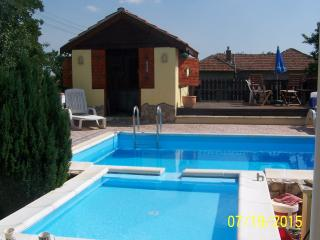 pool with kiddies paddling pool ,decking area and hot tub gazebo area