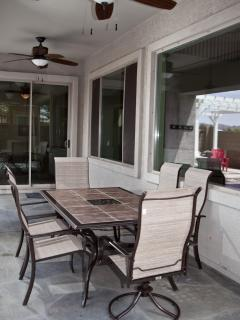 Outdoor patio with seating and 2 ceiling fans