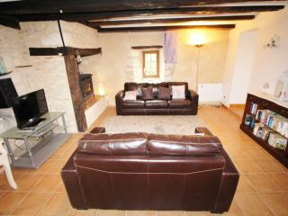 Lounge with 2 sofa's, flat screen TV and log burner