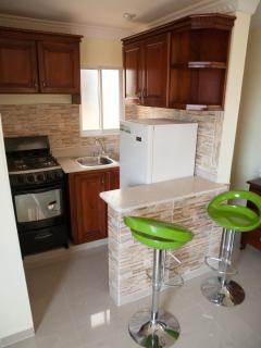 Studio apartment with fully furnished kitchen