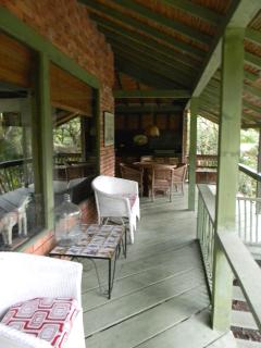 Porch and at the far end the dining table and open kitchen