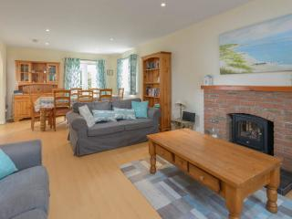 The open plan living room is a comfortable space to relax in after a hard day at the beach