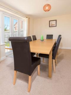 The dining table extends for family meals