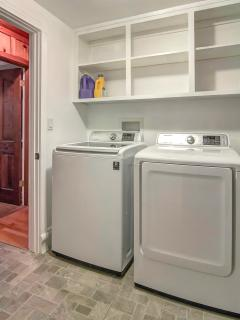 Utility room with a full-size washer and dryer