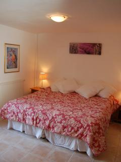 Bedroom 1 has a large double bed that can be split into 2 singles if required