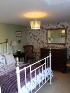 The master bedroom has mahogany antique furniture and a luxurious en-suite bathroom