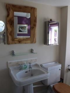 The en-suite bathroom has high quality fixtures and fittings