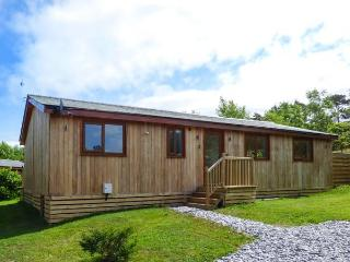 CARTMEL LODGE, detached log cabin, all ground floor, en-suite, woodburner