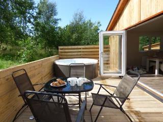 CARTMEL LODGE, detached log cabin, all ground floor, en-suite, woodburner