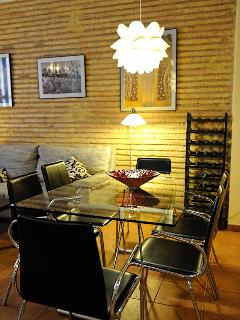 Dining table with original brick wall.