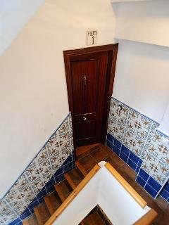 Door entrance with typical Valencian tiles on walls.