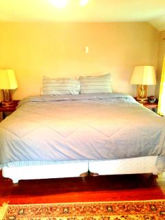 Master bedroom with king bed, 2 dressers, air conditioning, tv and dvd.